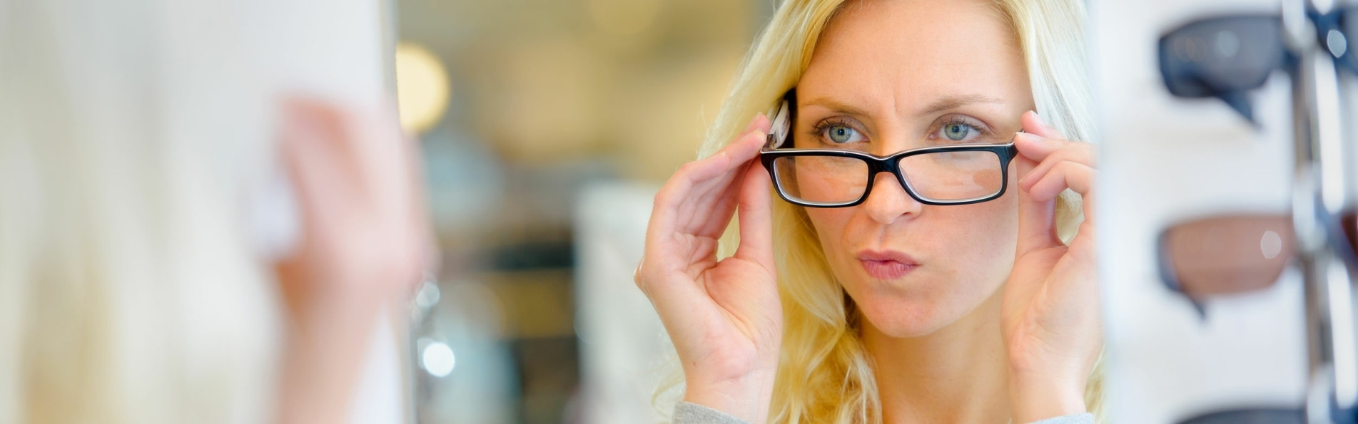 woman trying on glasses some